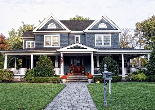 Exterior of a Shingled Home with a Large Front Porch