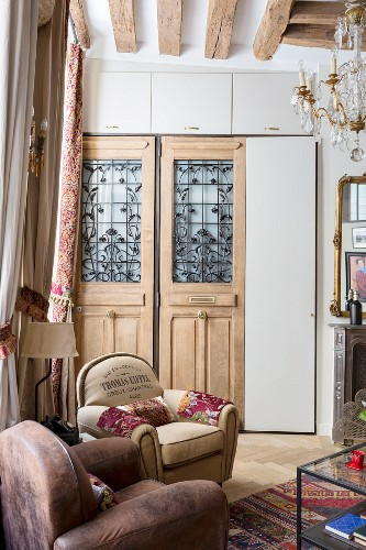Traditional front doors with floral grilles and letterboxes used as doors for fitted cupboard