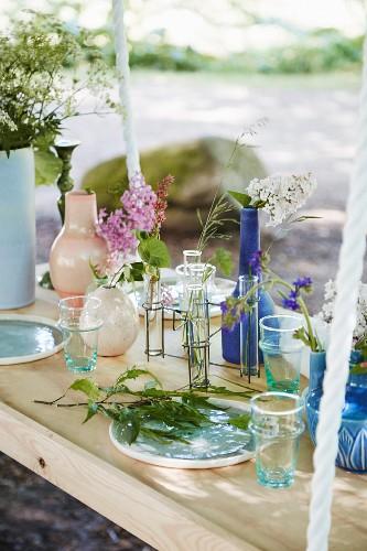 Flower arrangements on suspended table in garden