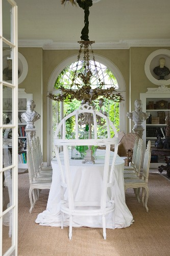 Throne and opulent chandelier in grand dining room