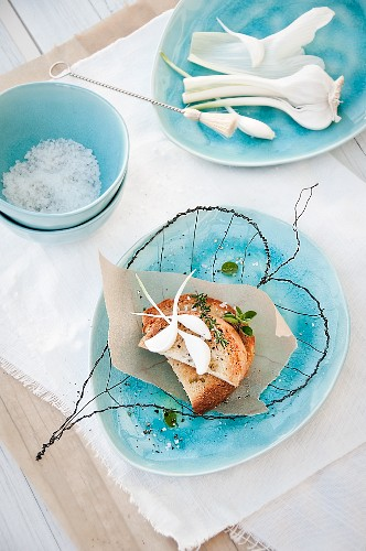 Snack in delicate wire leaf-shaped basket arranged on blue plate