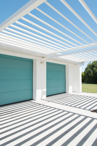 Rectilinear architecture and pattern of light and shadow outside garages