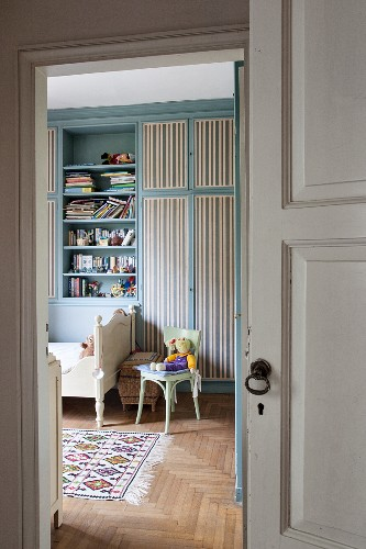 View of blue fitted cupboards in child's bedroom