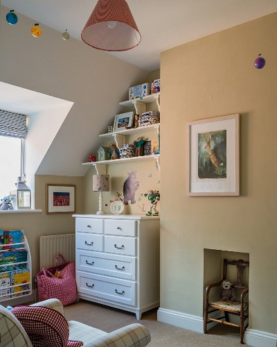 White chest of drawers in child's bedroom