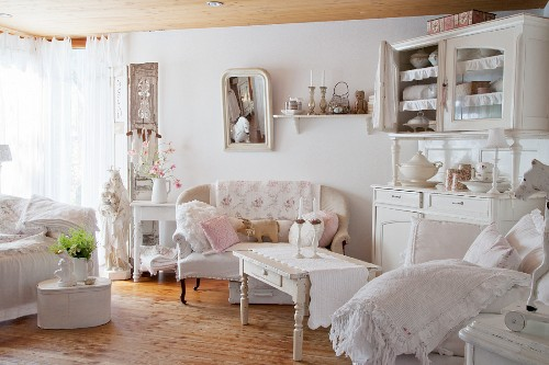 Shabby-chic sofa and dresser in living room