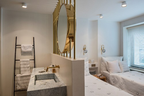 Large brass mirror above ensuite washstand in twin bedroom