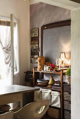 Chalkboard above open-fronted shelves in Mediterranean kitchen
