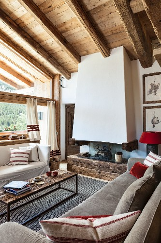 Wood-beamed ceiling and fireplace in rustic living room