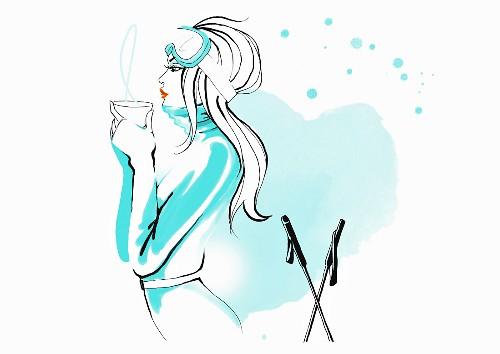 Woman skier drinking hot beverage