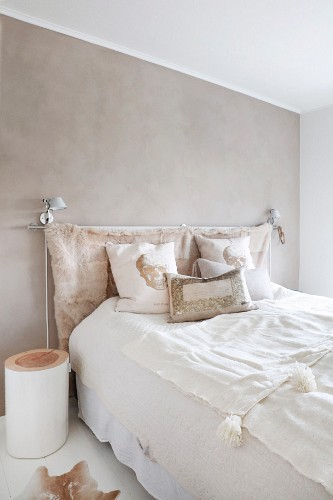 Double bed with animal-skin headboard