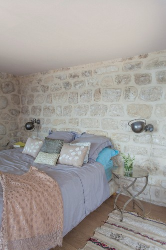 Oriental ambiance and stone walls in bedroom