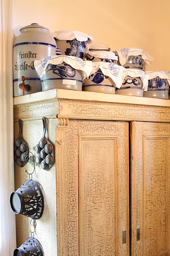 Stoneware pots on top of old wooden cupboard