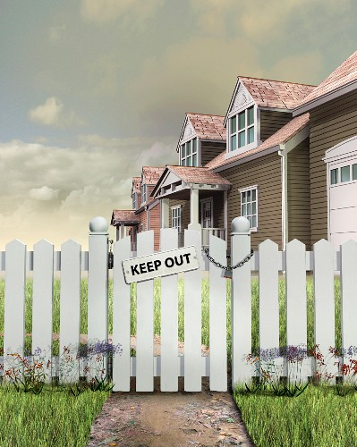 Keep Out sign on padlocked gate outside of house