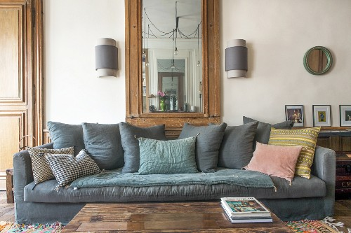 Grey velvet sofa with various scatter cushions