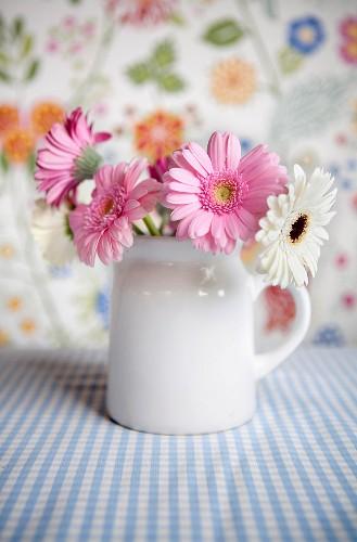Flower arrangement of gerbera daisies in a mug