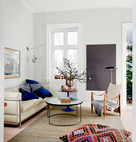 Designer furniture and wintry decorations in living room