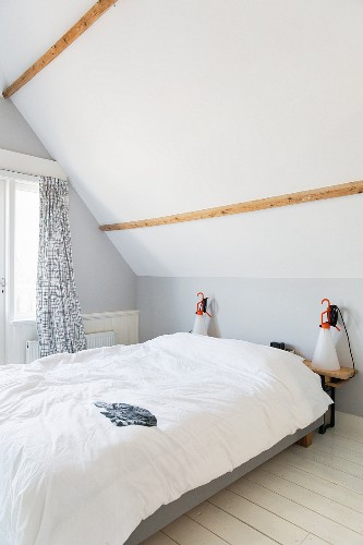 Simple attic bedroom in white and pale grey