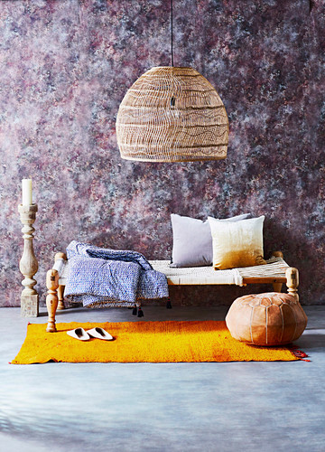 Basket light over an oriental day bed