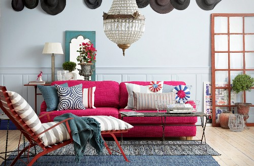 Pink sofa in colourful living room