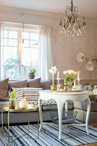 Festive arrangements on gilt, modern table and white, Baroque table