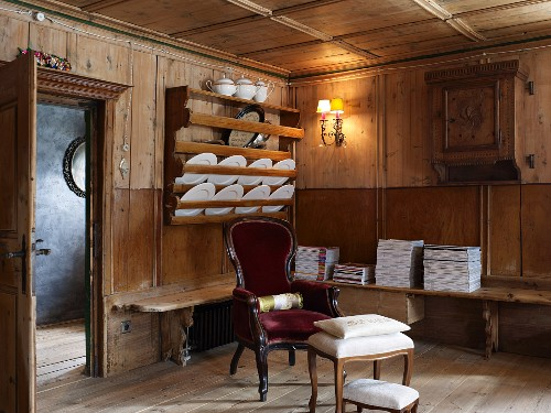 Antique furniture in wood-panelled parlour