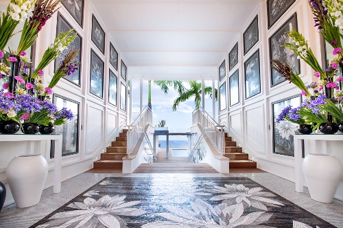 Panelled walls and flowers in glamorous foyer