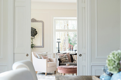 View through double sliding doors into French-style living room