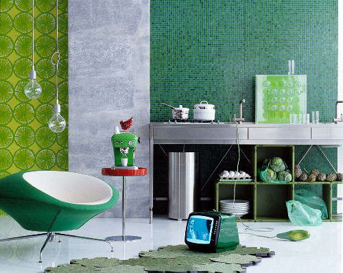 Open-plan kitchen in various shades of green