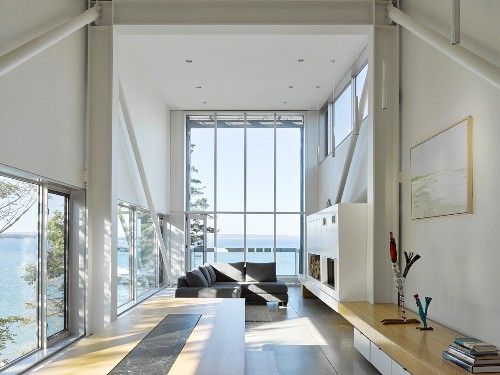 Living area in experimental beach-house with panoramic window and sea view
