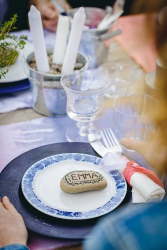 Name written on pebble on place setting