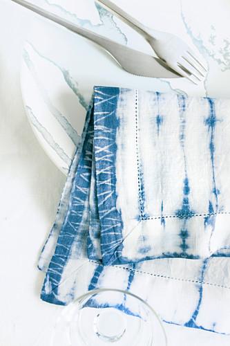Napkin hand-dyed using Shibori technique