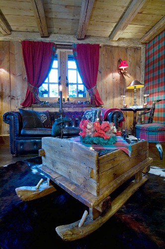 Old sledge used as coffee table in comfortable chalet living room