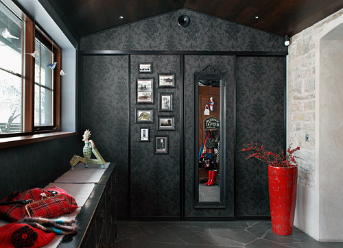 Mirror and gallery of pictures on sliding door in foyer