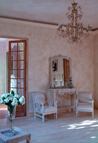French-style interior with lime-washed walls and chandelier