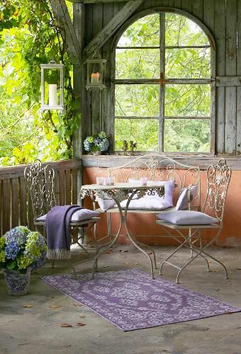 Ornate metal furniture on romantic veranda