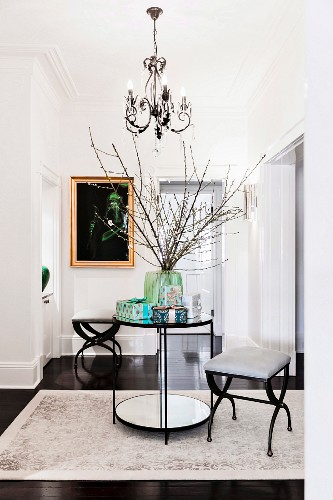 Elegant hallway in black and white with a round table