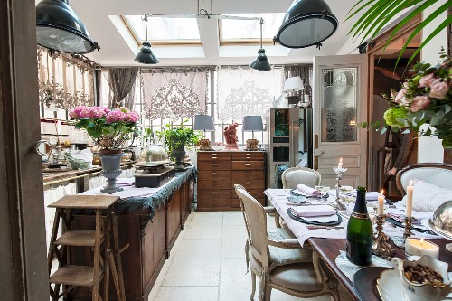 Festively set dining table in open-plan kitchen with vintage ambiance