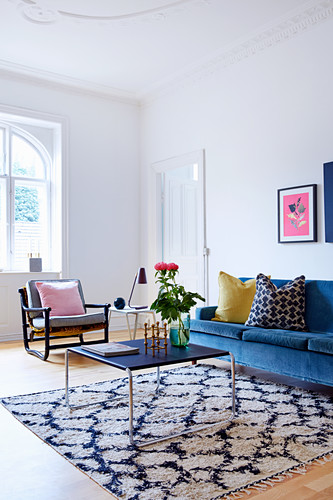 Blue sofa and delicate coffee table in living room of period apartment