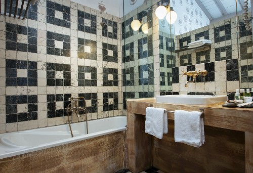 Mediterranean bathroom with pattern of black and white wall tiles