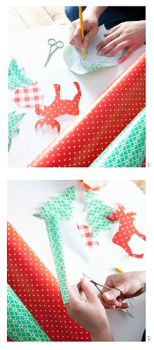 Painting and cutting out various festive motifs from adhesive film