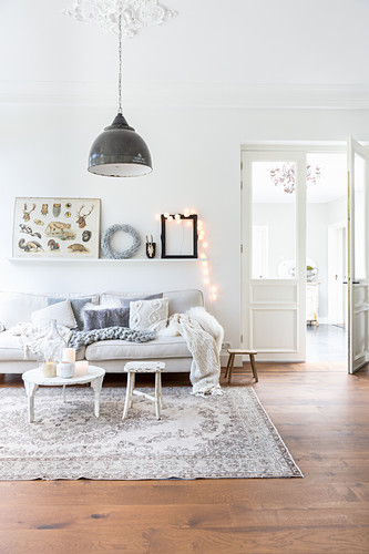 Bright living room in grey and white with wooden floor
