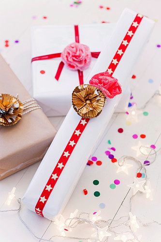 Wrapped gifts with flowers from muffin cuffs