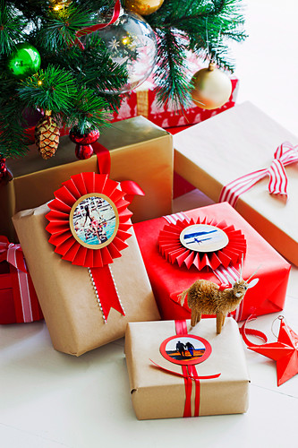 Wrapped gifts with photo tags and rosettes