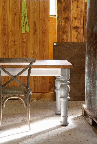 Wooden table with turned legs and bentwood chair in vintage sales room