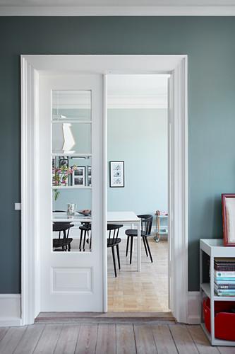 Open double doors with lattice windows leading into dining room