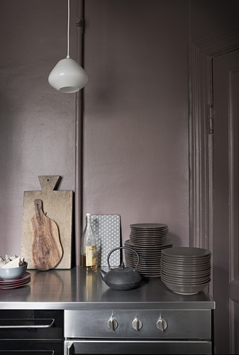 Worktop in kitchen with lilac-grey wal