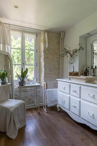 Antique white washstand in bathroom
