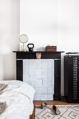 Disused fireplace in bedroom