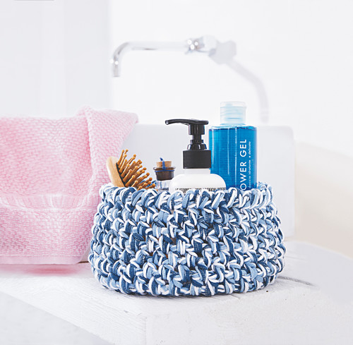 Crocheted bathroom basket in shades of blue