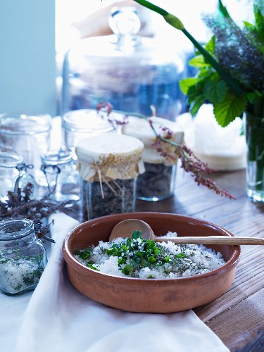 Wooden spoon in terracotta dish of herb salt